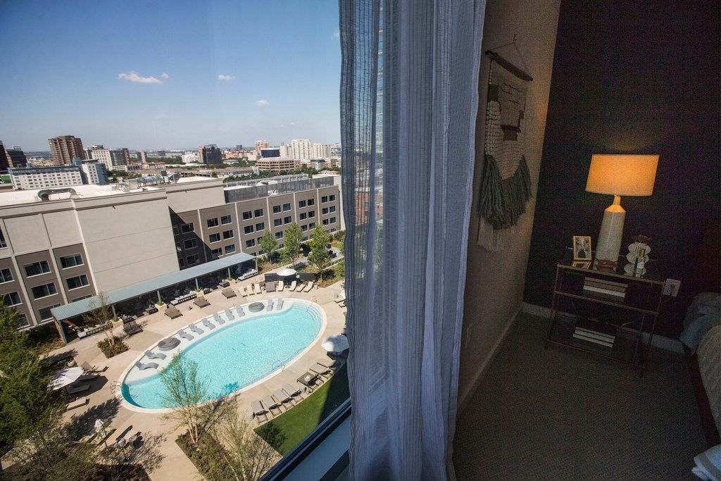 The view of the pool area from a model bedroom at Ardan apartments.