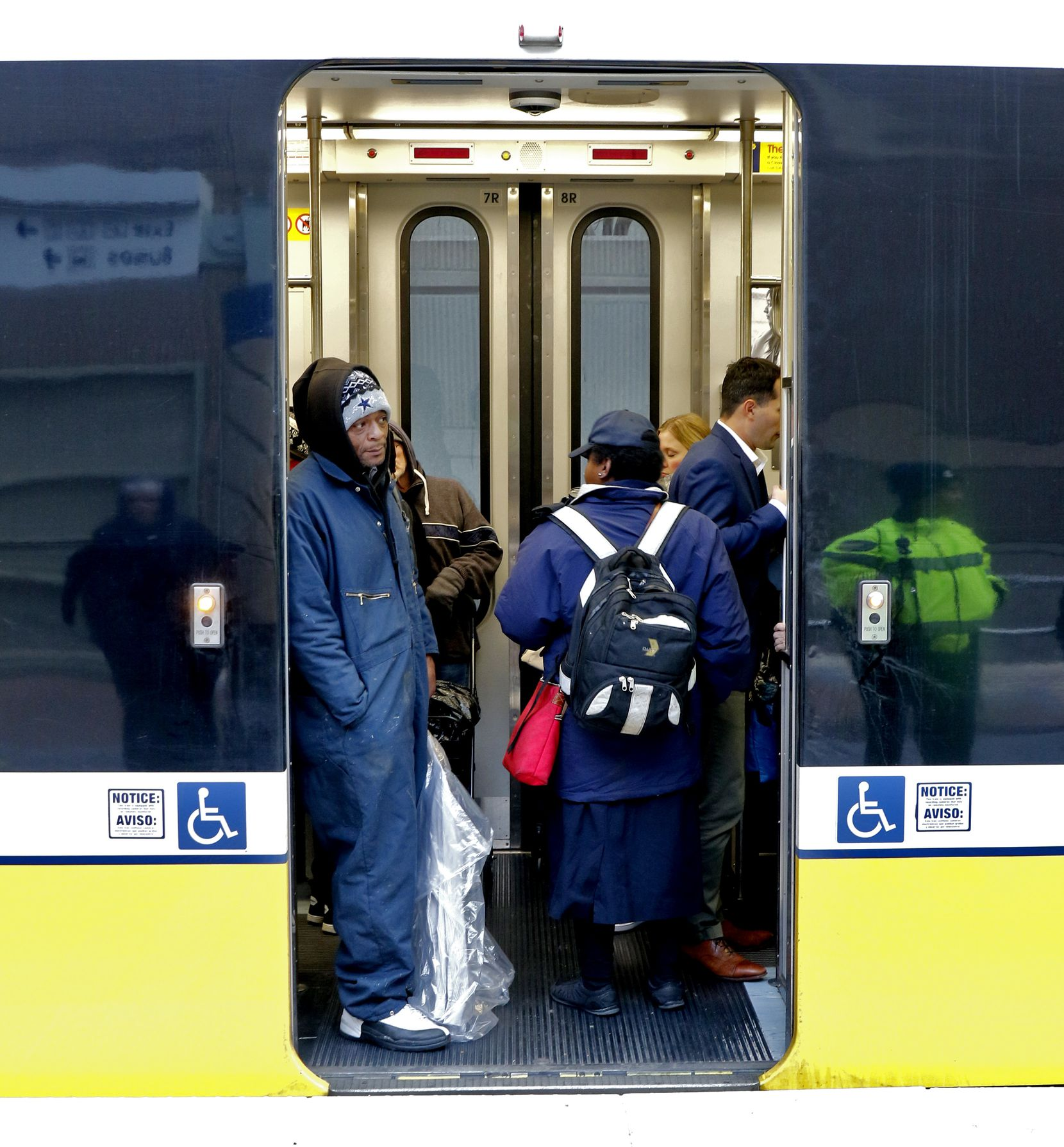 Passengers wait for DART train service at Mockingbird Station in Dallas, Texas. Problems with overhead power lines temporarily suspended train service in downtown Dallas the afternoon of Tuesday, Nov. 12.