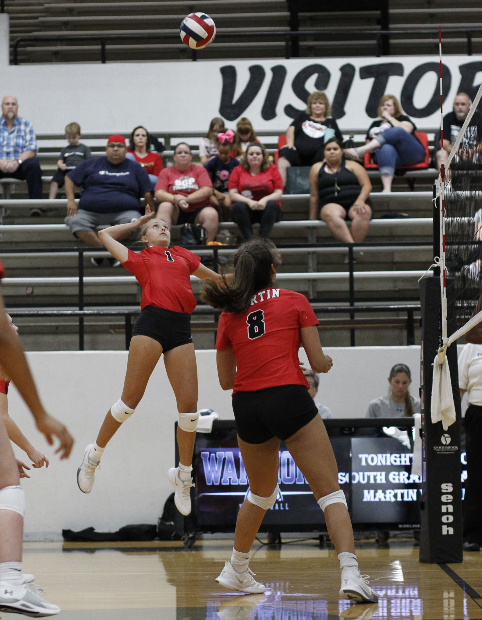 Arlington Martin's Desiree Reinwand (1) skies as she prepares to deliver a spike during the 3rd set of the Warriors' straight set victory over South Grand Prairie. The two teams played their volleyball match at Arlington Martin High School in Arlington on September 14, 2021. (Steve Hamm/ Special Contributor)