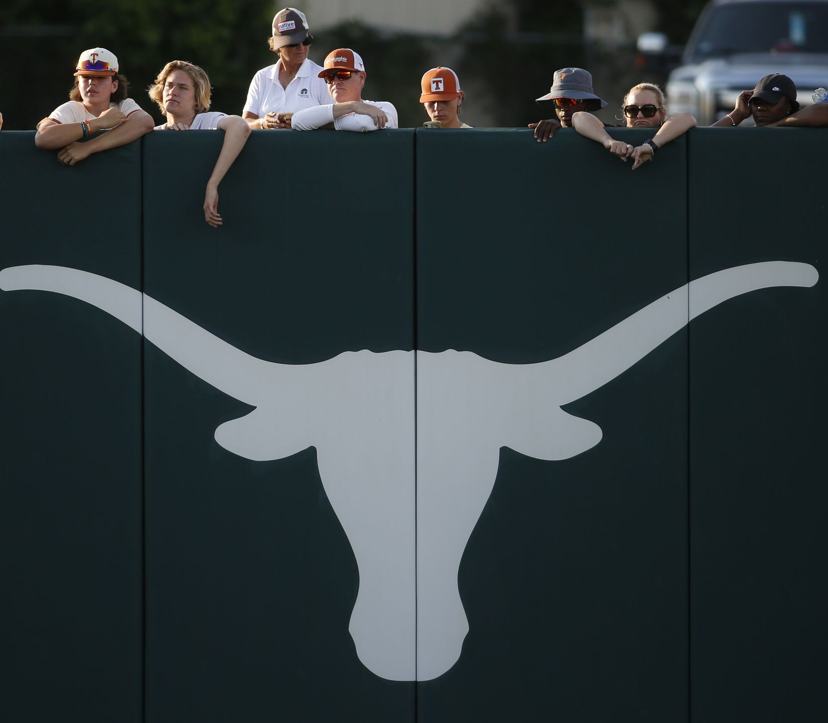 Fans watch from over the left field wall during the 7th inning of play between Aledo and Barbers Hill. The two teams played their UIL 5A state softball championship game at Red and Charline McCombs Field on the University of Texas campus in Austin on June 5, 2021. (Steve Hamm/ Special Contributor)