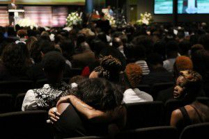 Mourners embraced during Taylor's funeral. (2015 File Photo/Andy Jacobsohn)