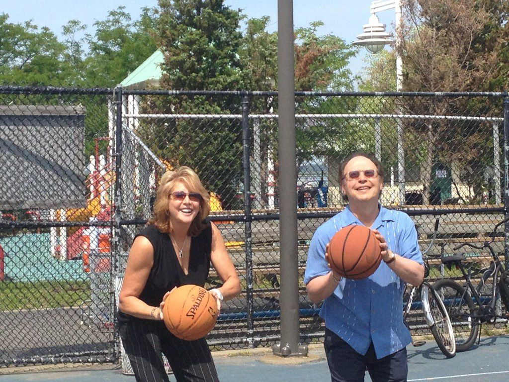 Basketball legend Nancy Lieberman and comedian Billy Crystal prepare for a shot at the November 2013 dedication of two $84,000 public courts paid for by Lieberman s foundation to help Crystal s hometown of Long Beach, N.Y. rebound from the devastation of superstorm Sandy. Crystal will appear in  at the Bomb Factory in Deep Ellum on Feb. 19 to raise money for her charity.