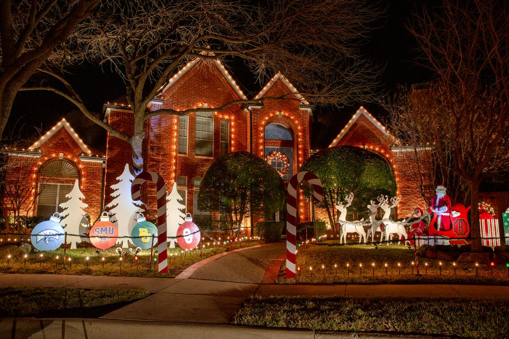 Holiday lights and decorations adorn houses in the Deerfield neighborhood in Plano.