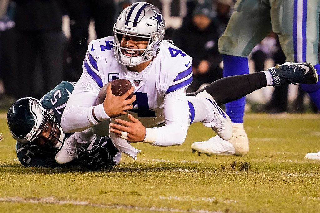 Dallas Cowboys quarterback Dak Prescott (4) is sacked by Philadelphia Eagles defensive end Vinny Curry (75) during the second half of an NFL football game at Lincoln Financial Field on Sunday, Dec. 22, 2019, in Philadelphia.