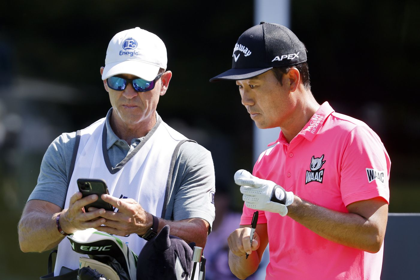 Golfer Kevin Na confers with his caddie before teeing off on No. 17 during the Charles Schwab Challenge Colonial Pro-Am at the Colonial Country Club in Fort Worth, Wednesday, May 26, 2021. Na won the tournament in 2019. (Tom Fox/The Dallas Morning News)