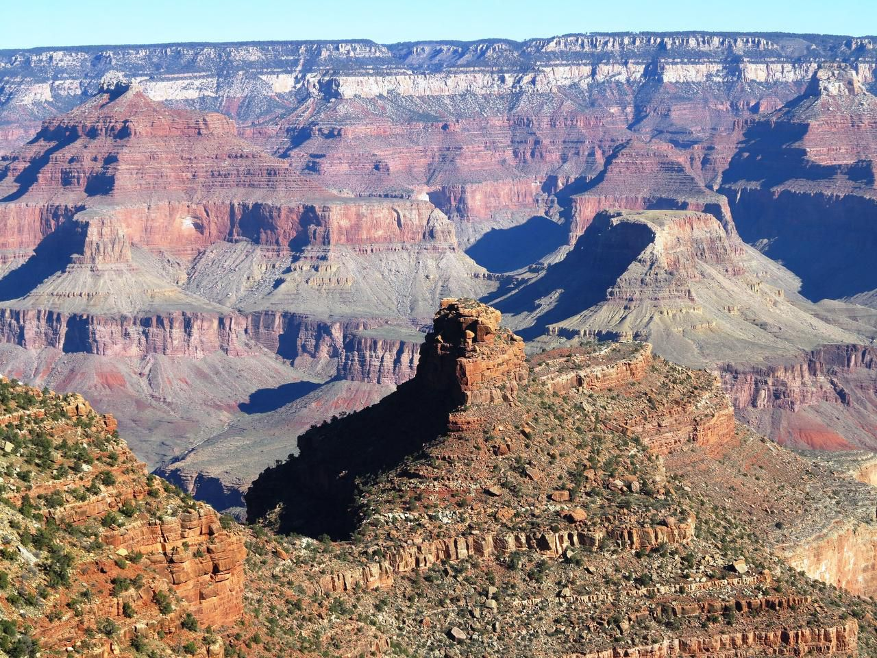 From the South Rim, visitors can take in striking views of the Grand Canyon and reflect on the billions of years of geologic processes that created such a massive landscape.