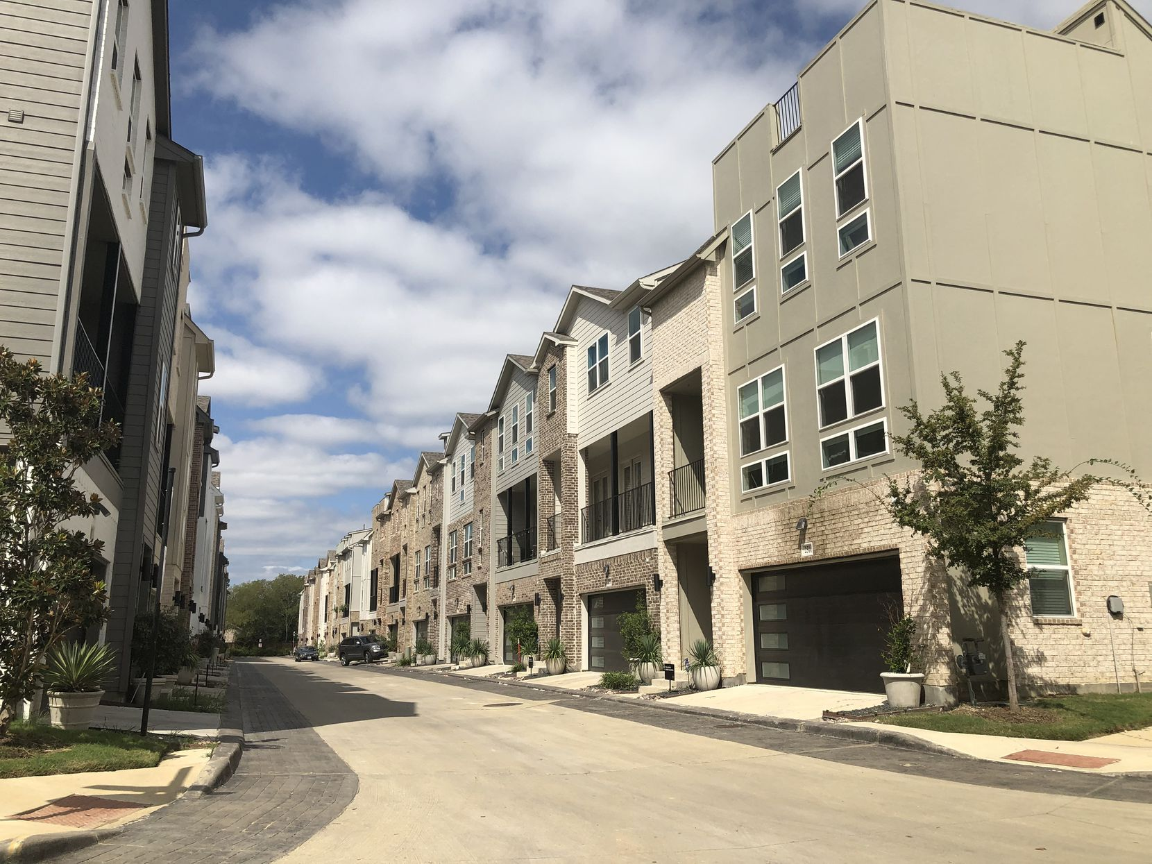The lagoon and planned multifamily buildings would be constructed next door to Megatel Homes' successful SoHo Square community in West Dallas.