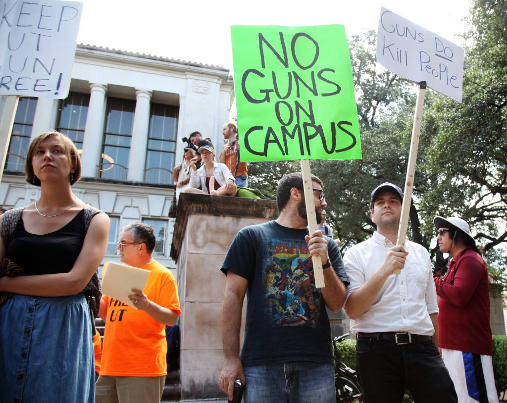 Students held signs and sex toys as they protested campus carry Aug. 24 in Austin.