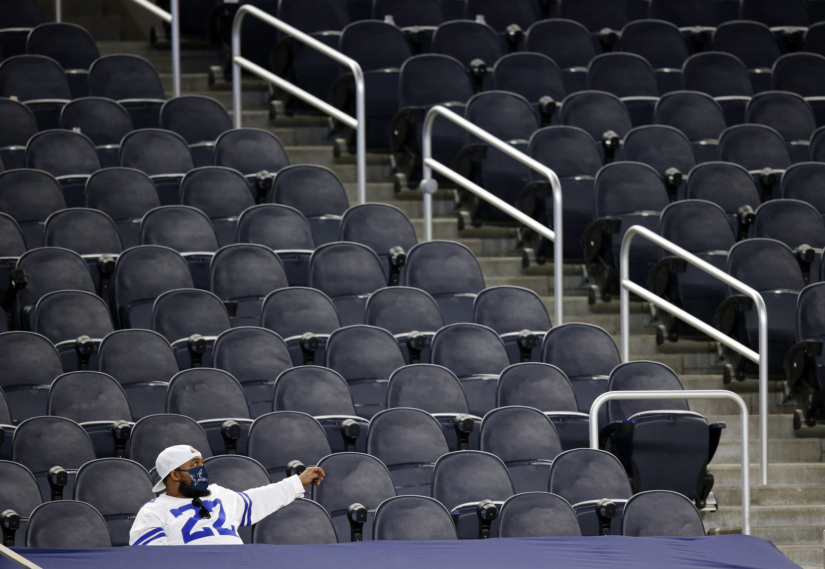 A lone Dallas Cowboys fan watches  from a nearly empty section as his team trailed the Washington Football Team in the fourth quarter at AT&T Stadium in Arlington, Thursday, November 26, 2020. The Cowboys lost, 41-16. (Tom Fox/The Dallas Morning News)