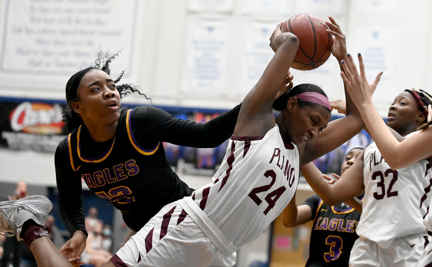 Plano's Amaya Brannon (24) grabs a rebound in front of Richardson's Kaia Ponder (12) in the second half of a Class 6A girls high school playoff basketball game between Plano vs. Richardson, Monday, Feb. 22, 2020, in Carrollton, Texas. (Matt Strasen/Special Contributor)