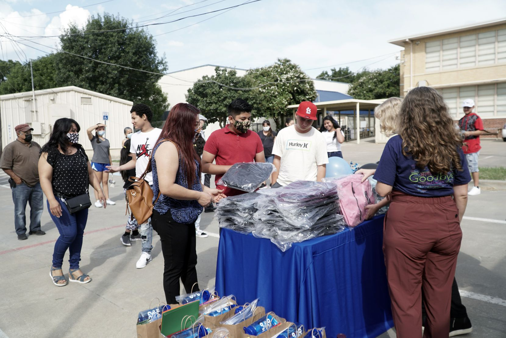 Families attended the International Newcomer Academy's Back to School Drive in Fort Worth. The campus not only offers language and educational support but helps students and parents with clothing, food and other needs.