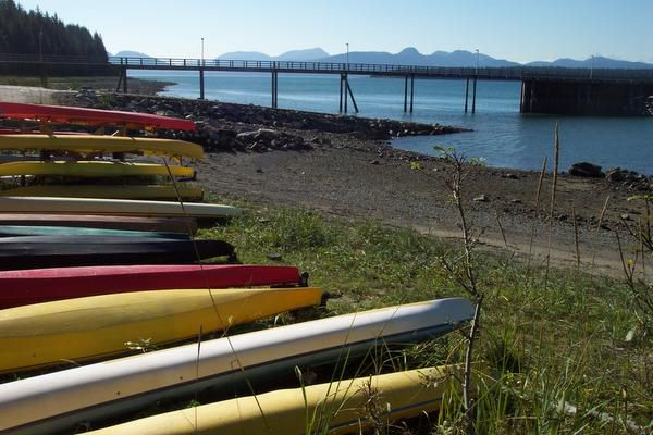 Kayaks are ready to go along the shore at Bartlett Cove in Glacier Bay National Park & Preserve.