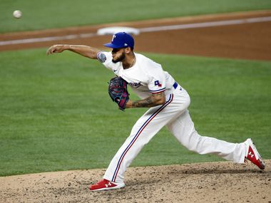 FILE - Rangers relief pitcher Jonathan Hernandez (72) delivers a pitch against the Oakland A's during the eighth inning at Globe Life Field in Arlington on Wednesday, Aug. 26, 2020.