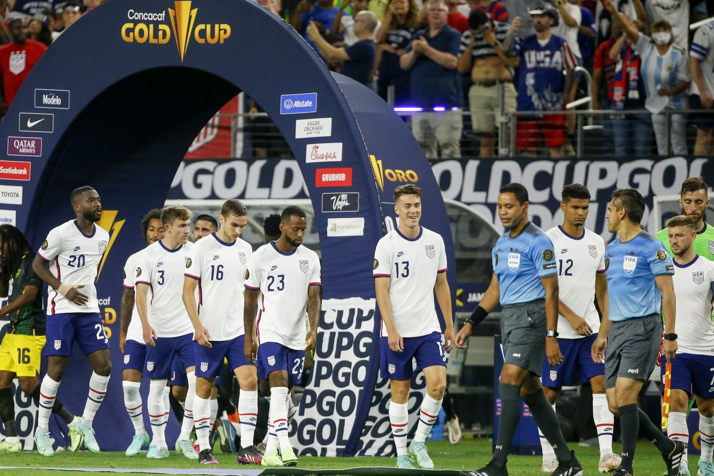 The USA men's national team enters the field before a CONCACAF Gold Cup quarterfinal soccer match against Jamaica at AT&T Stadium on Sunday, July 25, 2021, in Arlington. (Elias Valverde II/The Dallas Morning News)