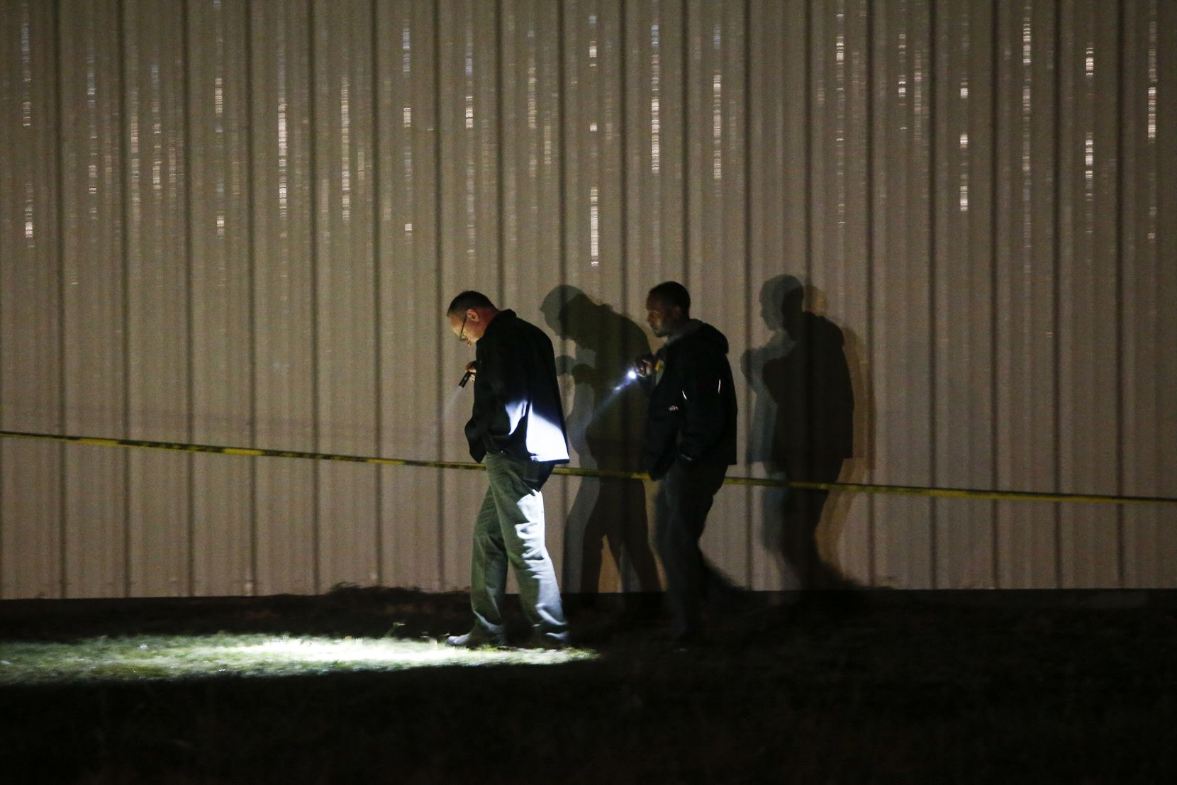 Investigators worked the crime scene after a shooting at the Party Venue on Highway 380 in Greenville.