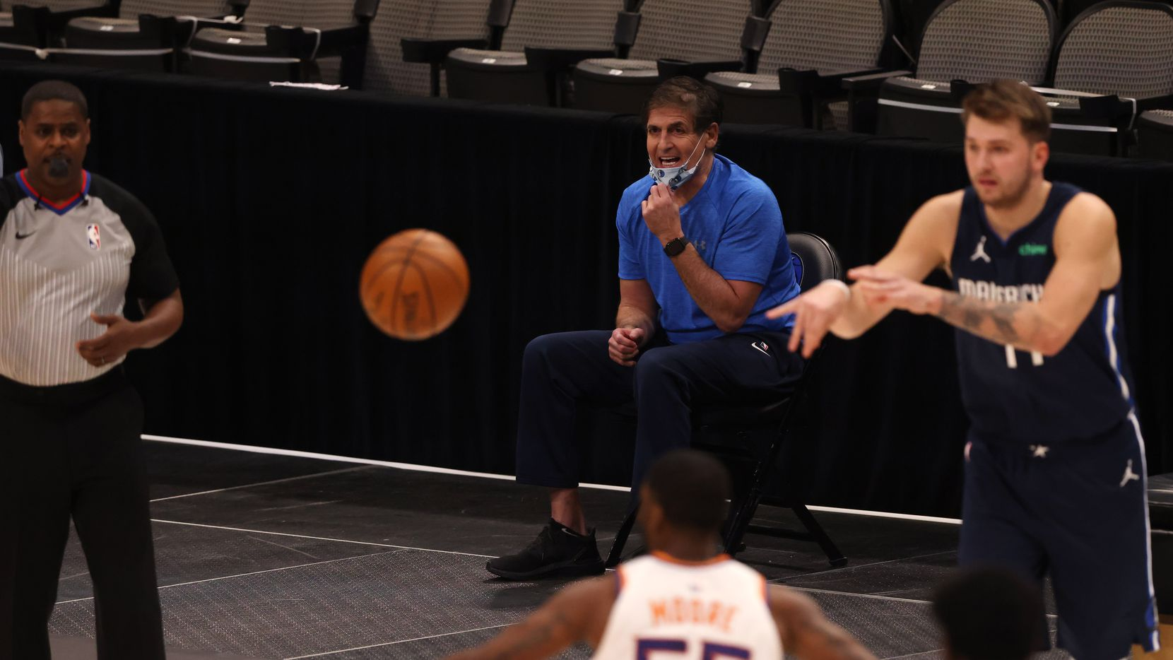 Dallas Mavericks owner Mark Cuban talks from the sideline in a game against the Phoenix Suns during the first quarter of play at American Airlines Center on Monday, February 1, 2021in Dallas. (Vernon Bryant/The Dallas Morning News)