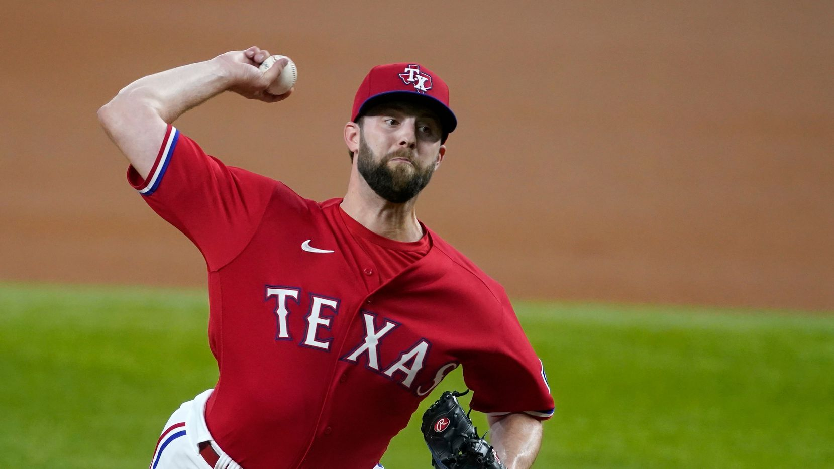 Texas Rangers starting pitcher Jordan Lyles throws to an Oakland Athletics batter during the first inning of a baseball game in Arlington, Texas, Friday, July 9, 2021.