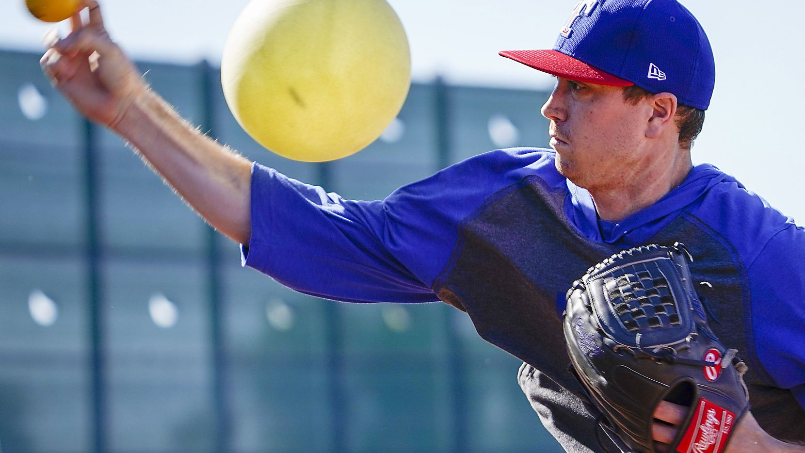 Texas Rangers pitcher Kyle Gibson works with a heavy ball and a connection ball (inflatable ball) during a spring training workout at the team's training facility on Friday, Feb. 14, 2020, in Surprise, Ariz.