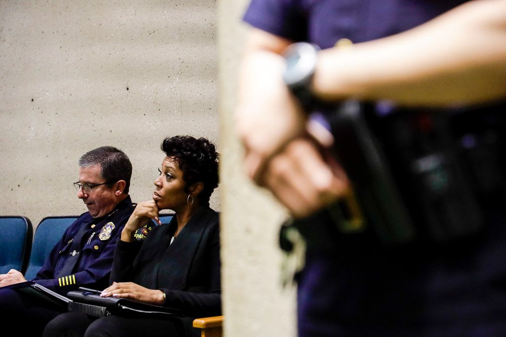 Dallas Police Chief U. Renee Hall (center) listens during a previous juvenile curfew public hearing at Dallas City Hall on Wednesday.