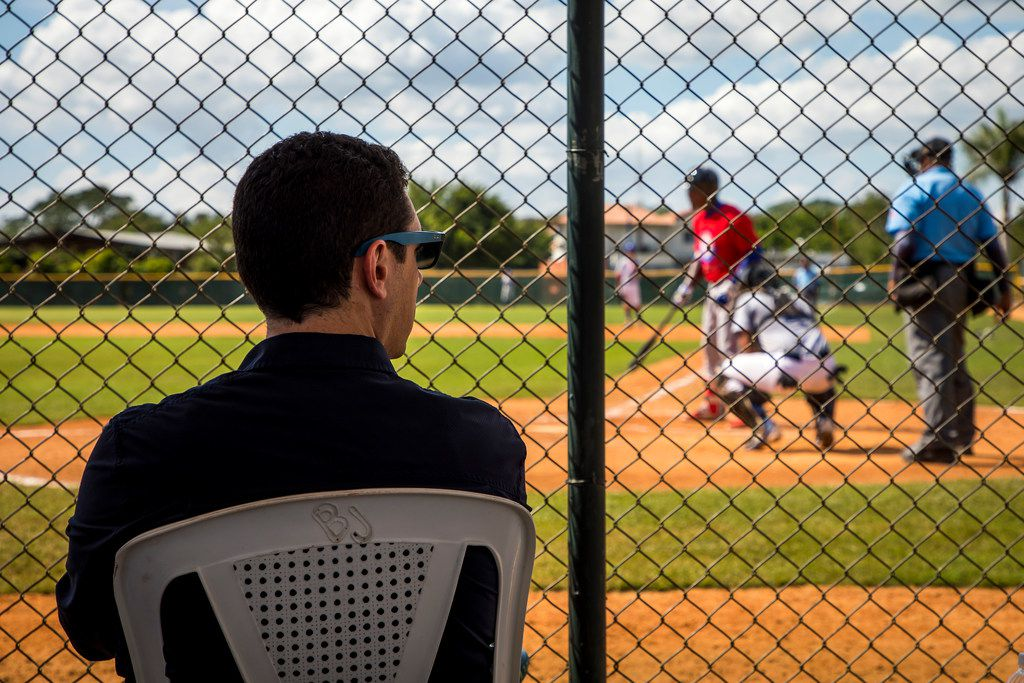 Texas Rangers general manager Jon Daniels watches a tryout game at the Texas Rangers Dominican Republic baseball academy complex on Monday, Jan. 22, 2018, in Boca Chica, Dominican Republic.