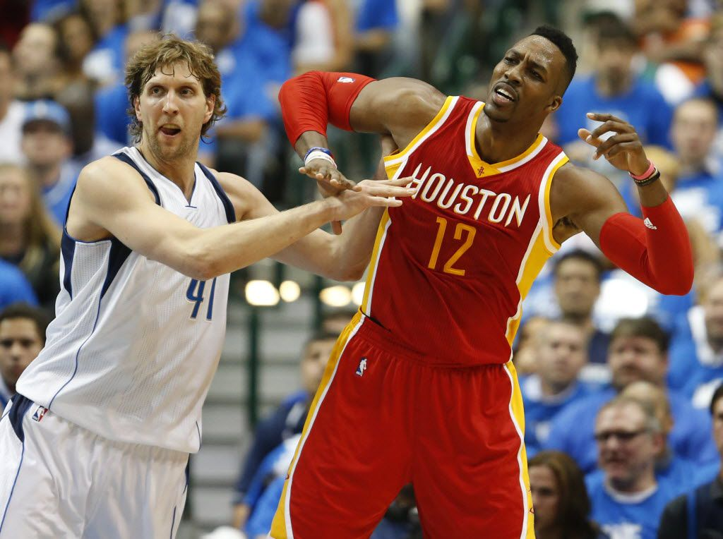 Dallas Mavericks forward Dirk Nowitzki (41) and Houston Rockets center Dwight Howard (12) fight for position during the first half of game 4 of the first round of the NBA playoffs at American Airlines Center in Dallas on Sunday, April 26, 2015. (Vernon Bryant/The Dallas Morning News)