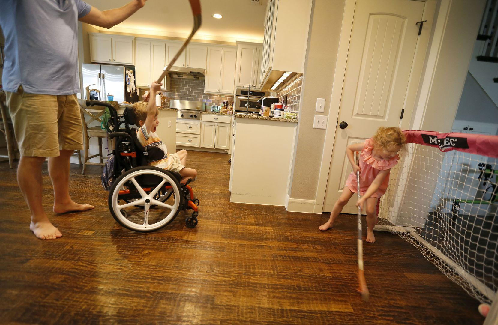 Will celebrates after he scores a goal while playing hockey with his sister, Lauren, in the living room at their home in McKinney, Texas, Wednesday, June 20, 2018.