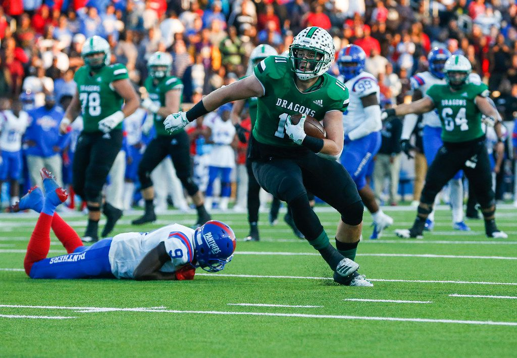 Southlake Carroll tight end Blake Smith (11) makes a break past Duncanville linebacker Paul Pickens (9) during the second half of a Class 6A Division I Region I high school football matchup between Southlake Carroll and Duncanville on Saturday, Dec. 7, 2019 at McKinney ISD Stadium in McKinney, Texas. (Ryan Michalesko/The Dallas Morning News)