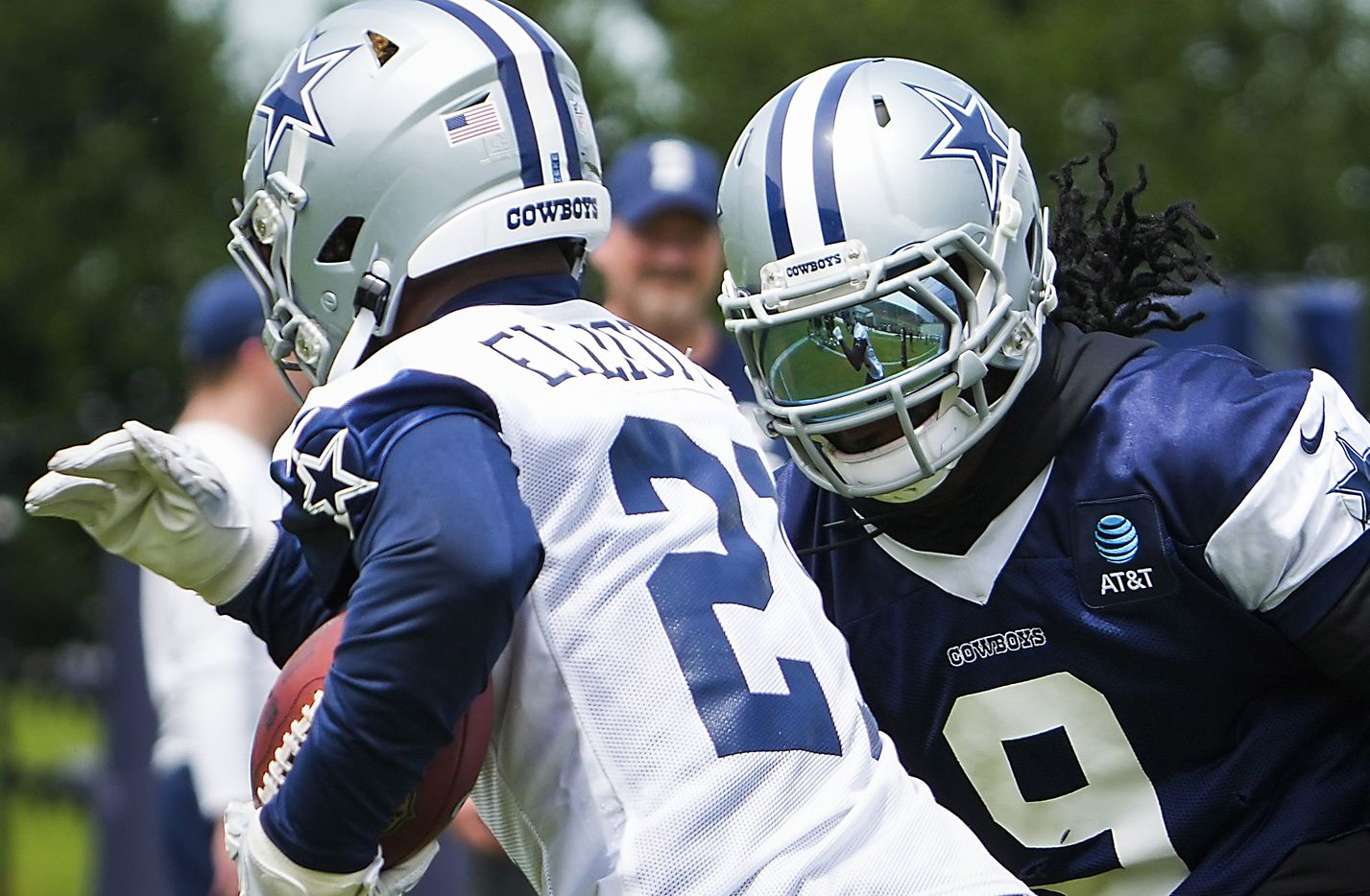Dallas Cowboys linebacker Jaylon Smith (9) chases running back Ezekiel Elliott (21) during a minicamp practice at The Star on Tuesday, June 8, 2021, in Frisco. (Smiley N. Pool/The Dallas Morning News)