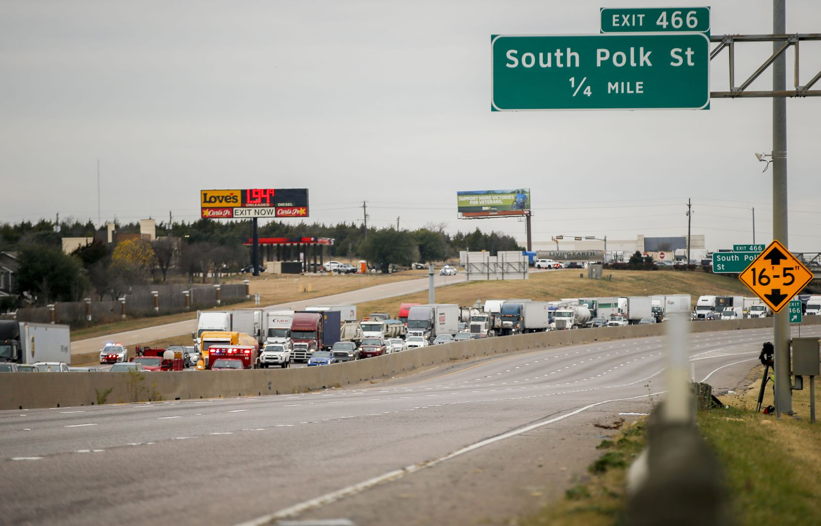 Both directions of traffic on I-20 at I-35E were shut down during a standoff between police and a suspect who refused to get out of his car Friday. The man eventually was taken into custody peacefully.