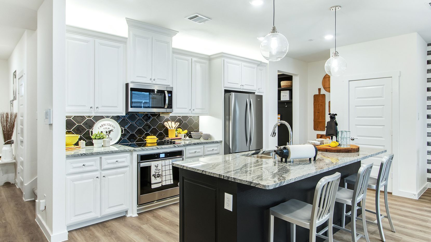 Two- and three-bedroom luxury townhomes are ready for move-in at Woodbridge Townhomes, a new Grenadier Homes community.