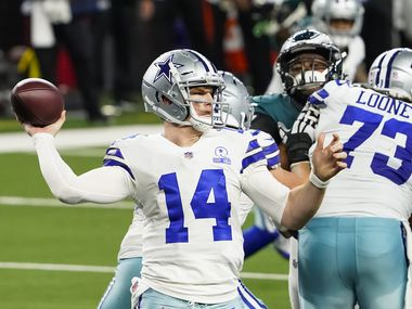 Dallas Cowboys quarterback Andy Dalton (14) gets a block from center Joe Looney (73) as he throws a pass during the third quarter of an NFL football game against the Philadelphia Eagles at AT&T Stadium on Sunday, Dec. 27, 2020, in Arlington.