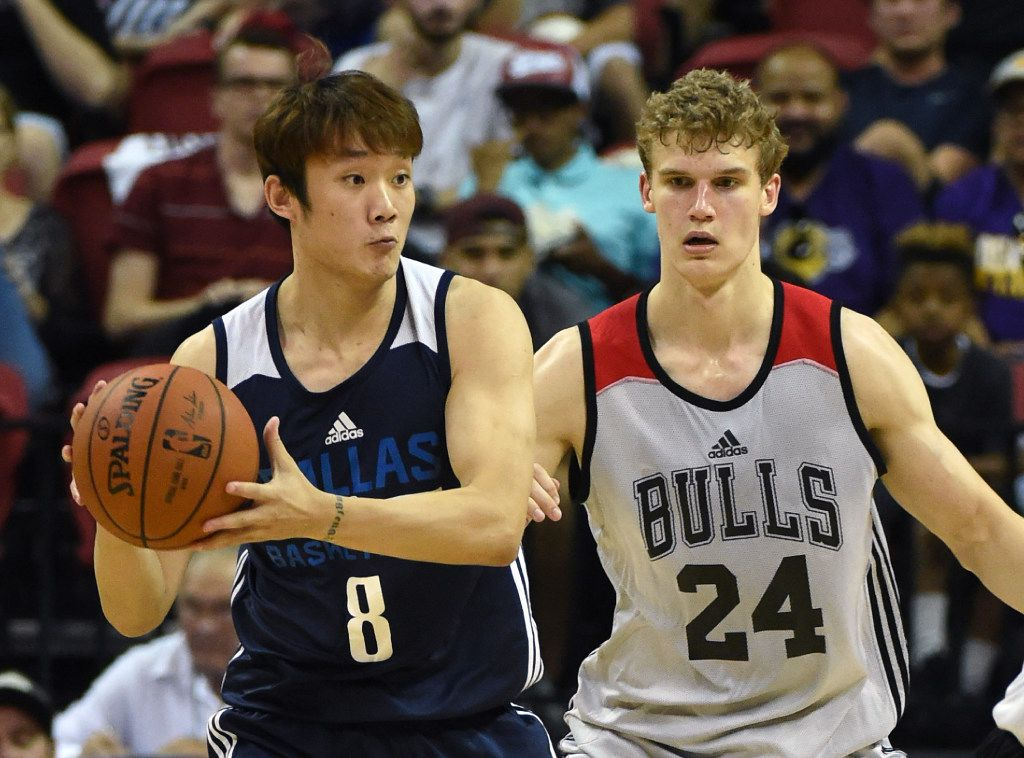 LAS VEGAS, NV - JULY 08:  Ding Yanyuhang #8 of the Dallas Mavericks  looks to pass against Lauri Markkanen #24 of the Chicago Bulls during the 2017 Summer League at the Thomas & Mack Center on July 8, 2017 in Las Vegas, Nevada. Dallas won 91-75. NOTE TO USER: User expressly acknowledges and agrees that, by downloading and or using this photograph, User is consenting to the terms and conditions of the Getty Images License Agreement.  (Photo by Ethan Miller/Getty Images)