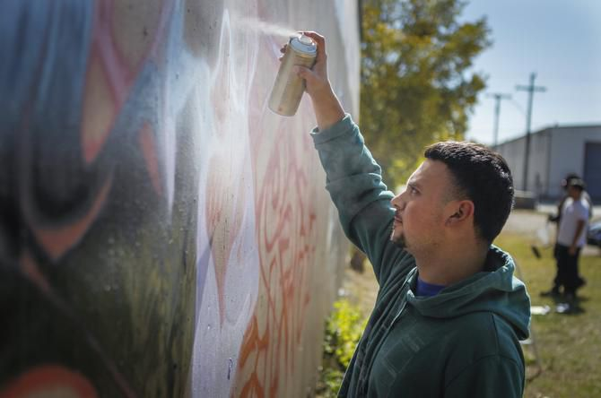 "Graffiti artist Irvin Botello, also know as ""Serfx,"" paints on the approved space on Fabrication Street."