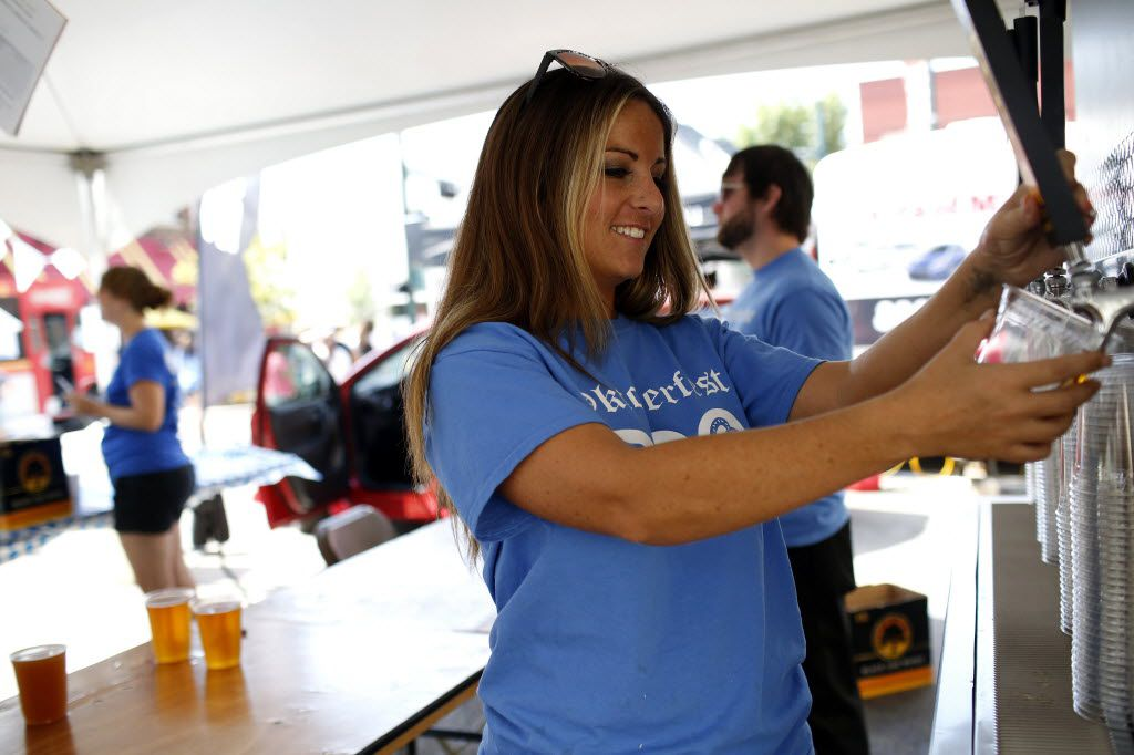 McKinney currently allows alcohol sales on city property for some large events like McKinney Oktoberfest, but not in its parks. In this 2015 photo, Destiny Downing pours a beer at Oktoberfest in historic downtown McKinney.