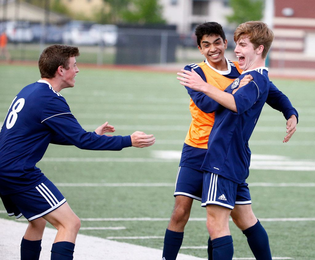 Flower Mound's Shane Popieluch (7), right, is mobbed by Aaditya Patil, center, and Nate Mulkey (18), left, after Popieluch scored the first goal against W.T. White during the Class 6A Regional I boys soccer quarterfinal in Irving, Texas on April 5 2019. (Michael Ainsworth)