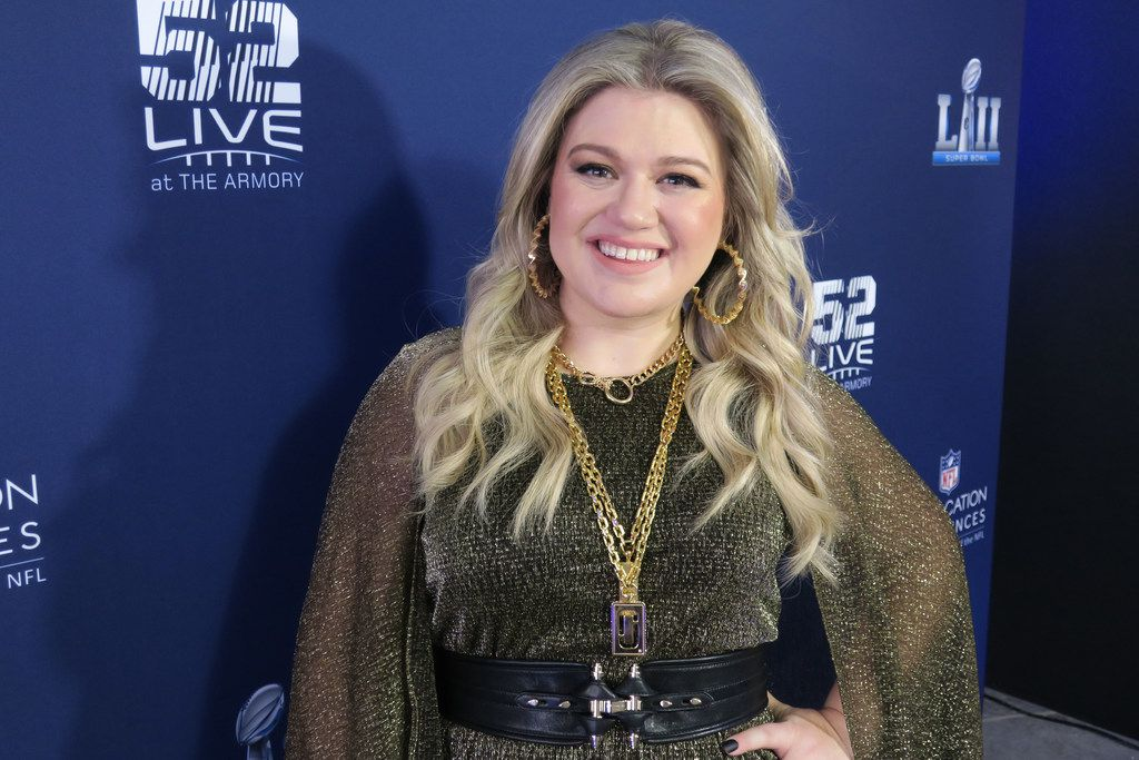 """Kelly Clarkson, shown at Nomadic Live at The Armory prior to the Super Bowl on Sunday, Feb. 4, 2018, joined the coaches on NBC's """"The Voice"""" this year. They've become a cozy bunch, with her giving them handmade gifts."""