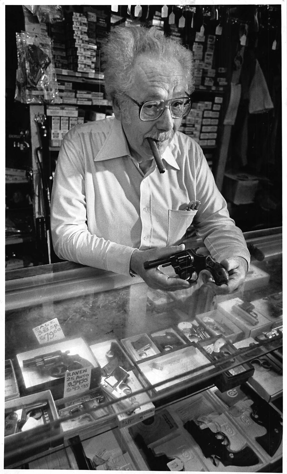 Rocky Goldstein, shown with a handgun of the type purchased by John Hinckley in October 1980. Goldstein owned Rocky's Pawn Shop at 2018 Elm St.