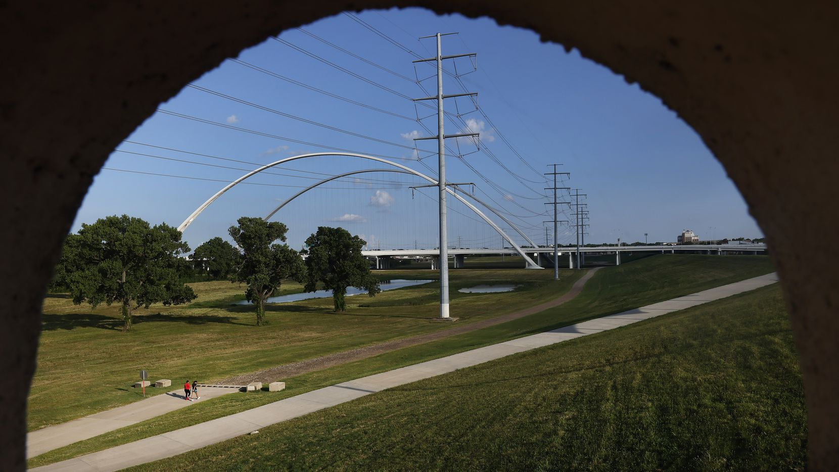 Large electrical transmissions lines are pictured along the Trinity River levee and Margaret McDermott Bridges near downtown Dallas, Wednesday, June 30, 2021. (Tom Fox/The Dallas Morning News)