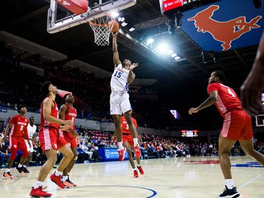 Southern Methodist Mustangs forward Isiaha Mike (15) goes up for a shot during the first half of a basketball game between SMU and University of Houston on Saturday, February 15, 2020 at Moody Coliseum in Dallas. (Ashley Landis/The Dallas Morning News)