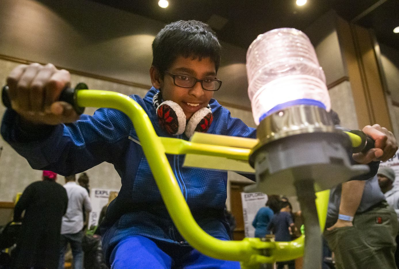 Charan Ashok, 10, from McKinney, Texas, pedals a bicycle to light up a lightbulb in the science exhibit section of the Day 1 Dallas festival held this year at the Embassy Suites Conference Center in Frisco, Texas, on Wednesday, Jan. 1, 2020. Day 1 Dallas is a kid-friendly New Year's Day festival that features rock-climbing, arts and crafts, bounce houses, and a fireworks show.