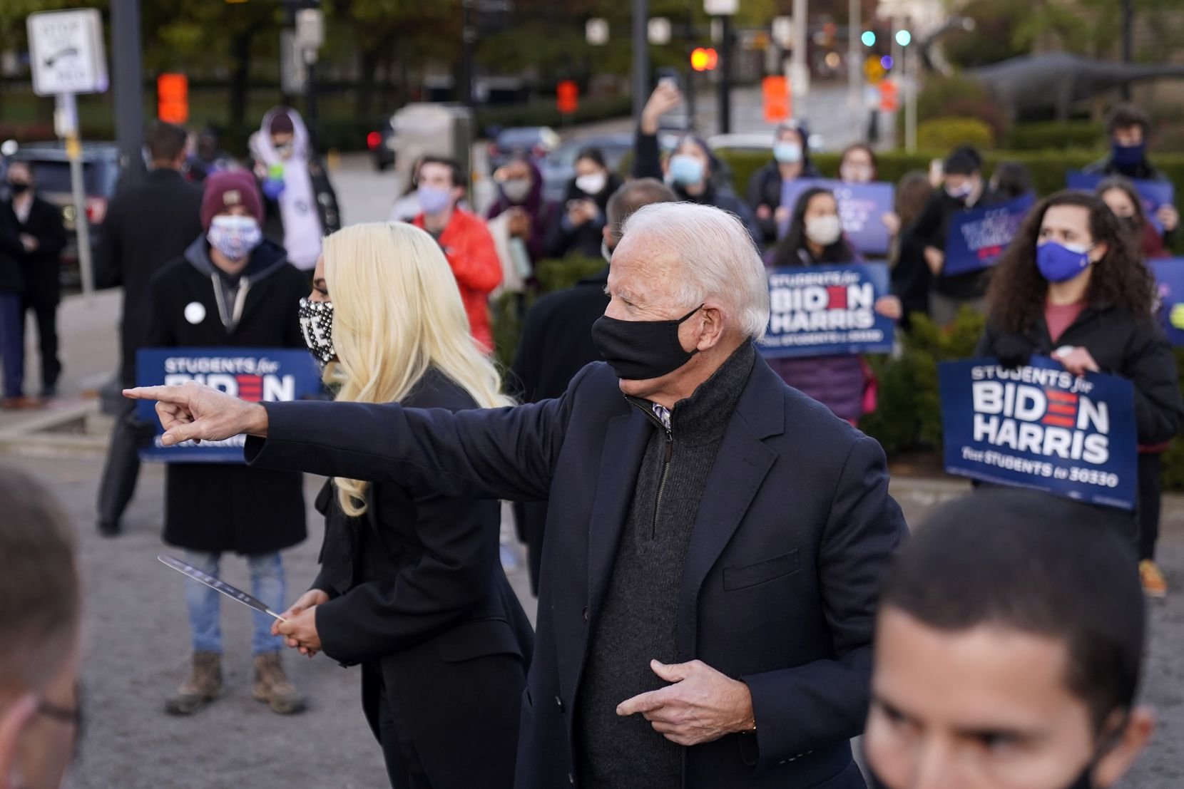 Former Vice President Joe Biden stands with Lady Gaga at Schenley Plaza in Pittsburgh, Pa., on the final day of campaigning, Nov. 2, 2020.