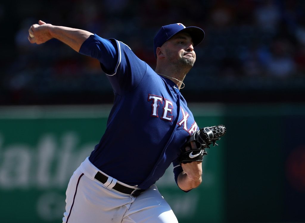 ARLINGTON, TEXAS - AUGUST 18:  Taylor Guerrieri #46 of the Texas Rangers throws against the Minnesota Twins in the sixth inning at Globe Life Park in Arlington on August 18, 2019 in Arlington, Texas. (Photo by Ronald Martinez/Getty Images)