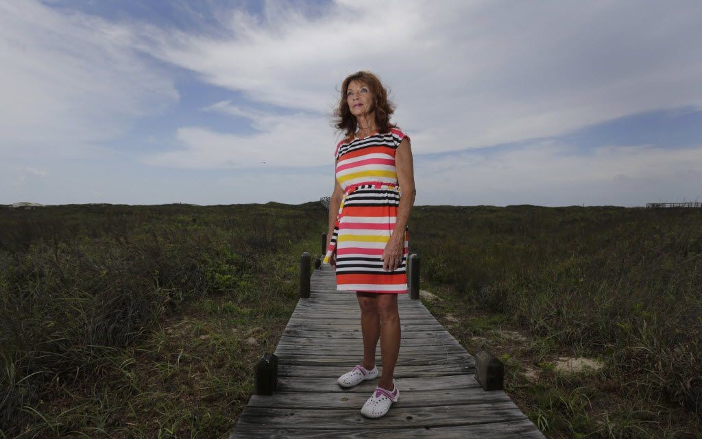 Sonia Cacy poses for a photo on a boardwalk near her home, Tuesday, June 24, 2014, in Port Aransas, Texas. Cacy, who is now on parole, has waited decades for a hearing on whether her murder conviction should be overturned. She has fought for more than 20 years to clear her 1993 conviction in the death-by-fire of her uncle, Bill Richardson, in Fort Stockton, Texas.