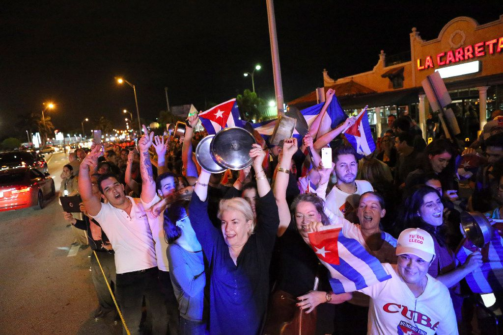 Cuban-Americans celebrate the death of Fidel Castro early Saturday in the Little Havana area in Miami. (David Santiago/El Nuevo Herald via AP)
