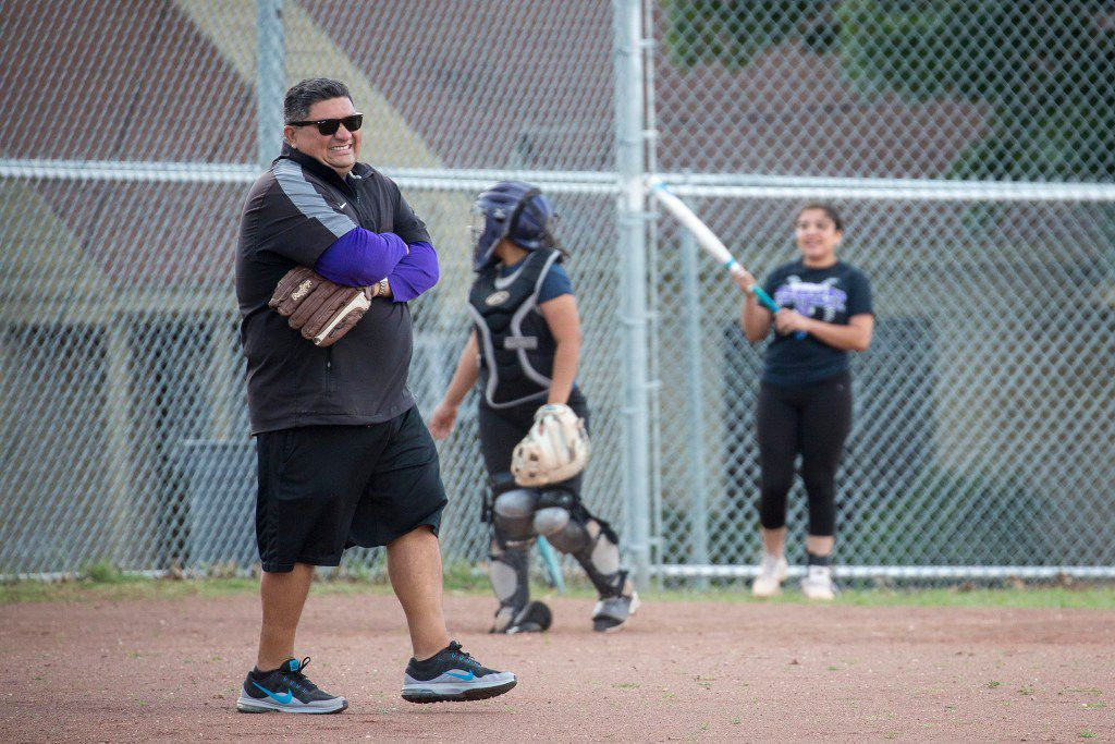 Chris Castillo works with his team during softball practice at Sunset High School on Thursday, May 4, 2017, in Dallas. Castillo is Sunset's football coach and athletic coordinator, but he has had to fill in as the softball coach during the playoffs because softball coach Kim Whittington got called into duty for two weeks for the Army Reserves. (Smiley N. Pool/The Dallas Morning News)