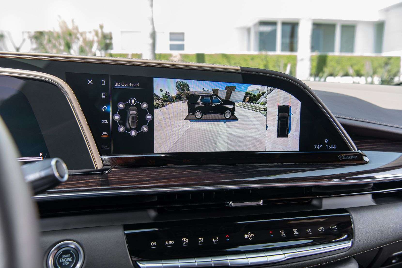 """The OLED display in the 2021 Escalade includes a 16.9"""" diagonal infotainment screen that displays and controls navigation, music, and many other functions of the vehicle, including HD Surround vision, which uses multiple camera angles to display an overhead image of the area round the vehicle."""
