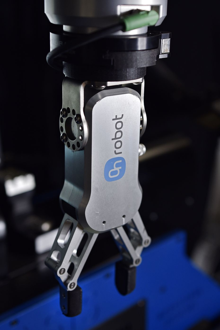 An OnRobot electric gripper is used by All Axis Machining in Dallas. The machine shop has seven robots that are used for tasks, including sanding metal and checking for quality control.