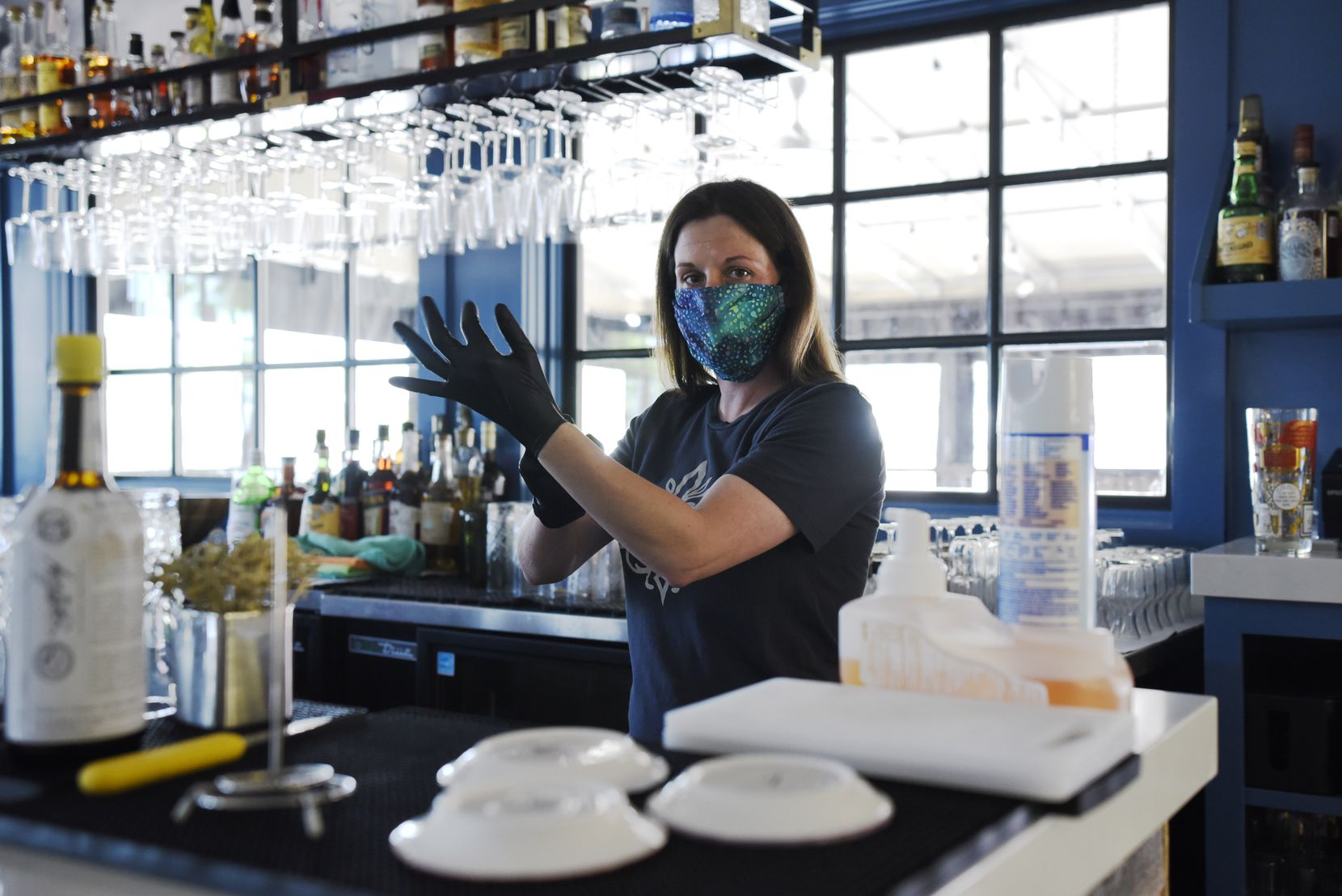 Bartender Tara Dieringer says safety, not money, is her biggest worry as she makes decisions about returning to work. She's a bit uneasy about the close contact with guests, but she's confident of the restaurant's safety and cleaning protocols.