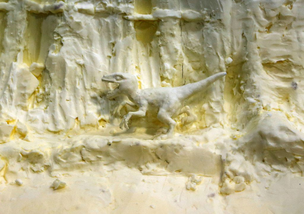 A little dinosaur close to the bottom of a butter sculpture in the Creative Arts building at the State Fair of Texas in Dallas on Sunday, October 1, 2017. (Vernon Bryant/The Dallas Morning News)