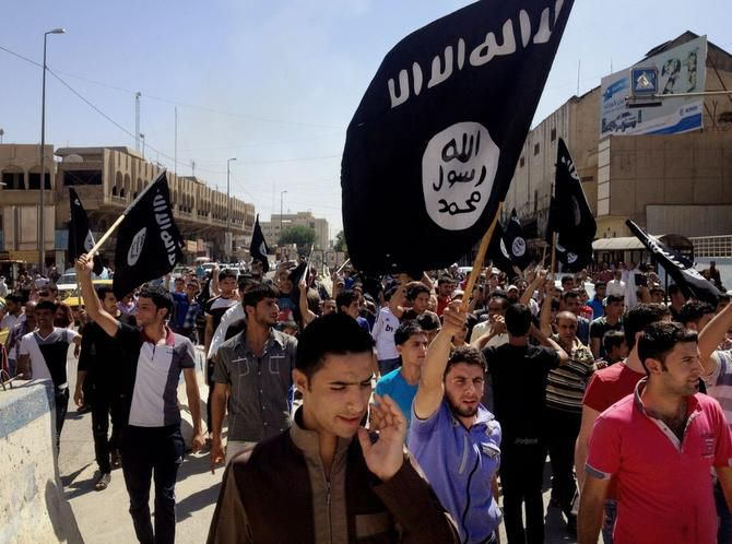 Demonstrators in Mosul, Iraq, carry al-Qaeda flags and chant slogans to support the Islamic State, also known as ISIS.
